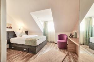 Ein Bett oder Betten in einem Zimmer der Unterkunft Hotel Tiffany