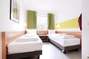 A bed or beds in a room at bestprice Hotel Aachen City