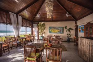 Um restaurante ou outro lugar para comer em Pousada Tabapitanga