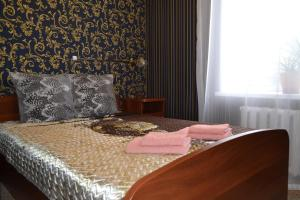 Кровать или кровати в номере Гостевой Дом Неолит