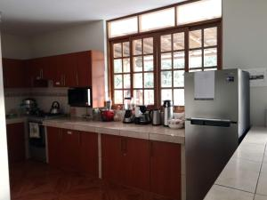 A kitchen or kitchenette at Casa de Campo Chinkay - Lunahuana