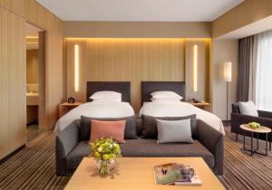 A bed or beds in a room at Hyatt Regency Beijing Wangjing