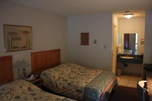 A bed or beds in a room at Sunwapta Falls Rocky Mountain Lodge