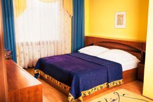 Кровать или кровати в номере Отель Экватор Лайт