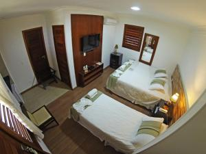 A bed or beds in a room at Hotel Vale das Nuvens