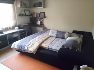 A bed or beds in a room at Homestay Syariah Cileunyi, Bandung Timur