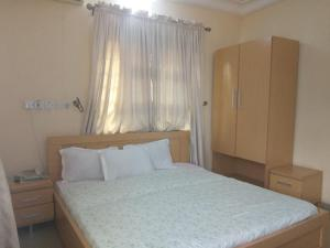A bed or beds in a room at Jem Guest House