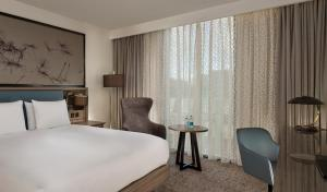 A bed or beds in a room at Doubletree By Hilton Hull