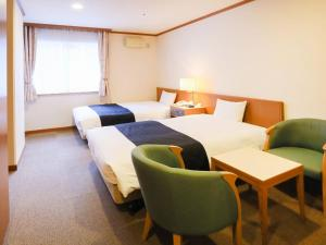 A bed or beds in a room at APA Hotel Sapporo Susukino Ekinishi