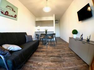 A seating area at Adria Marina Appartamenti Aprilia Marittima Costa Nord Adriatica