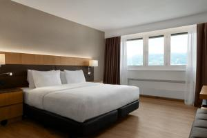A bed or beds in a room at AC Hotel by Marriott Innsbruck