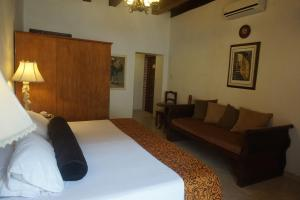 A bed or beds in a room at Casa India Catalina