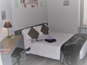 Un ou plusieurs lits dans un hébergement de l'établissement Hôtel Akena HF