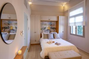 A bed or beds in a room at ATHÉNÉE RESIDENCE by K&K