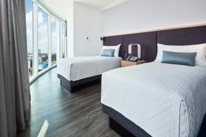 A bed or beds in a room at Universal's Aventura Hotel