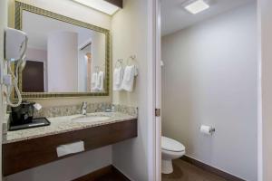 A bathroom at Sleep Inn