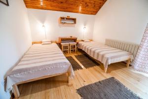 Кровать или кровати в номере Farm Stay Žagar