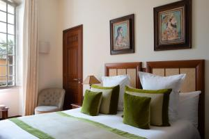 A bed or beds in a room at Pan Dei Palais