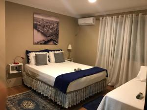 Cama ou camas em um quarto em Suítes Bouganville