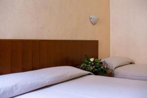 Letto o letti in una camera di Hotel Astor