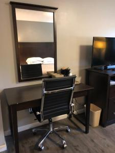 A television and/or entertainment center at Deerfield Inn and Suites - Fairview