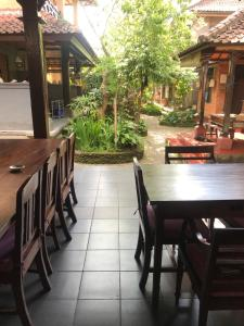 A restaurant or other place to eat at Nirvana Pension