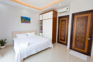 Giường trong phòng chung tại CBD Home - Home in Central - The Art