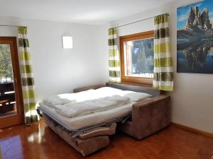 A bed or beds in a room at Residence La Zondra