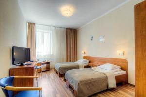 Кровать или кровати в номере Золотой Якорь