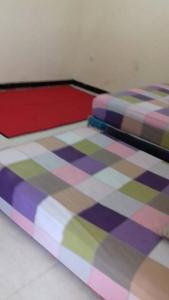 A bed or beds in a room at Villa Ardon Batu