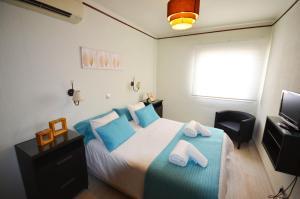 Cama o camas de una habitación en La Torre - Villa Rosamar Beach