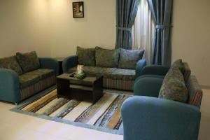 Uma área de estar em Dorar Darea Hotel Apartments - Al Nafl