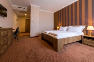 A bed or beds in a room at Sky Hotel