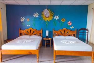 A bed or beds in a room at El Mirador Ecológico, Ometepe