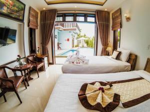 Un ou plusieurs lits dans un hébergement de l'établissement Cam Thanh Village Villas