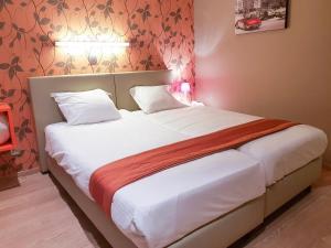 Een bed of bedden in een kamer bij Hotel Castel