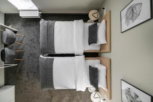 Vonios kambarys apgyvendinimo įstaigoje Senamiesčio apartamentai