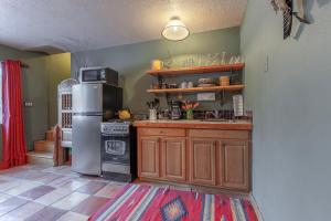 A kitchen or kitchenette at Adobe and Pines Inn Bed and Breakfast