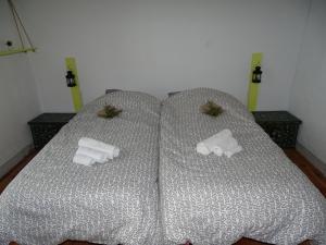 Uma cama ou camas num quarto em Penhas da Saúde