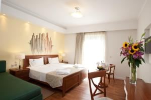 A bed or beds in a room at Mediterranean Beach Resort