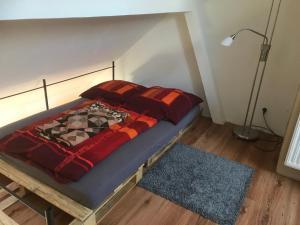 Ein Bett oder Betten in einem Zimmer der Unterkunft Steins Fewo 79 und 77