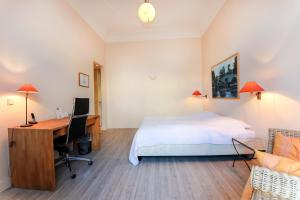 Ein Bett oder Betten in einem Zimmer der Unterkunft Aparthotel York