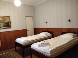 Vuode tai vuoteita majoituspaikassa Gasthaus Pooki