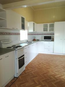 A kitchen or kitchenette at Walk to Beach Queenslander HOME in CBD Hervey Bay