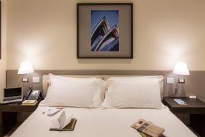 A bed or beds in a room at UNAHOTELS Bologna Fiera