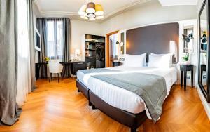 Un ou plusieurs lits dans un hébergement de l'établissement Hotel Grande Italia