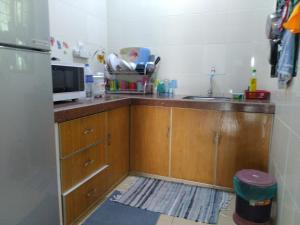 A kitchen or kitchenette at Izzanial Homestay