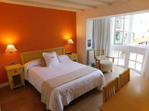Cama o camas de una habitación en Hotel Palacete