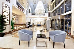 O saguão ou recepção de Iridium 70 Hotel