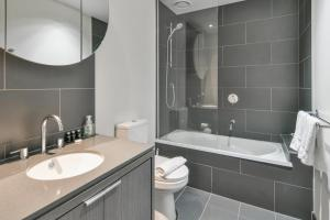 A bathroom at Sanctuary Apartments - Wrap